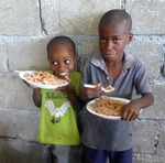 Two boys happily eating